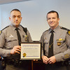 WARREN DILLAWAY / Star Beacon<br /> OHIO STATE Highway Patrol Trooper Brandon Miller (left) received a certificate honoring his lifesaving work on Februry 4 in Harpersfield Township. He received the  citation from Captain Chris J. Zurcher who is the Cleveland District Commander.