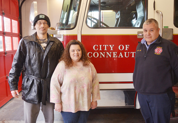 WARREN DILLAWAY / Star Beacon<br /> TINA TAYLOR of Conneaut and her boyfriend Phillip Johnson meet Captain Tim Zee of the Conneaut Fire Department on Tuesday at the Conneaut Fire Department. Zee performed Cardio Pulmonary Resitation on Taylor earlier this month helping save her life during a heart attack.