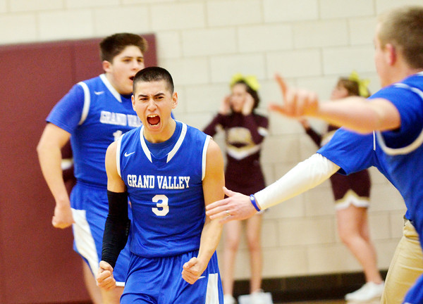 WARREN DILLAWAY / Star Beacon GABE KOVATS (3) of Grand Valley celebrates with teammates after the Mustangs defeated Pymatuning Valley in a  Division III sectional seminal in Andover Township.