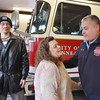 WARREN DILLAWAY / Star Beacon<br /> TINA TAYLOR of Conneaut hugs Captain Tim Zee of the Conneaut Fire Department as Taylor's boyfriend Phillip Johnson looks on Tuesday at the Conneaut Fire Department. Zee performed Cardio Pulmonary Resitation on Taylor earlier this month helping save her life during a heart attack.