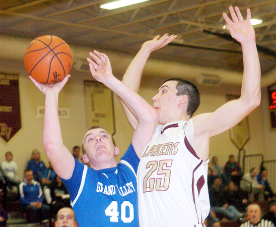 WARREN DILLAWAY / Star Beacon<br /> MATT MOODT (40) of Grand Valley drives to the basket while Chase Thurber of Pymatuning Valley defends on Tuesday night during Division III sectional semifinal action in Andover Township.