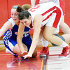 WARREN DILLAWAY / Star Beacon<br /> KAILEIGH SLOAN (right) of Edgewood battles for the ball with Jessica Vormelker of Grand Valley on Monday night at Edgewood.