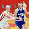WARREN DILLAWAY / Star Beacon<br /> JESSICA VORMELKER of Grand Valley drives to the basket with Carrie Pascarella of Edgewood defending on Monday evening at Edgewood.