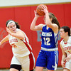 WARREN DILLAWAY / Star Beacon<br /> JESSICA VORMELKER (12) of Grand Valley is surrounded by Cortney Humphrey (55) and Edgewood teammate Haley Holden (1) on Monday evening at Edgewood.