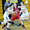 WARREN DILLAWAY / Star Beacon<br /> EMILY SMOCK (1) of Jefferson defends Ashley Plassard of Riverside on Tuesday evening in Painesville Township.