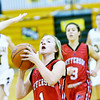 WARREN DILLAWAY / Star Beacon <br /> EMILY SMOCK of Jefferson (1) prepares to shoot over the outstretched arm of a Riverside defender on Tuesday evening at Riverside with Ashley Plassard (21) and fellow Riverside player Kirsten Punsart (30) and Jessica Becker (3) and fellow Falcon Sarah Brook (right) following the play.