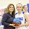 WARREN DILLAWAY / Star Beacon<br /> JESSICA VORMELKER of Grand Valley receives a commemorative basketball after she scored her1,000 point during a home game with  Badger Thursday evening in Orwell. She poses with head coach Kim Triskett.