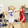 WARREN DILLAWAY / Star Beacon<br /> ABBY PASKEY (15) of Grand Valley and Taylor Kramar of Badger reach for the ball on Thursday evening in Orwell.
