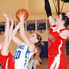 WARREN DILLAWAY / Star Beacon<br /> CHRIS FUTTY (30) of Grand Valley tries to shoot between Badger defenders Liz Emery (left) and Harlee Logan on Thursday night in Orwell.