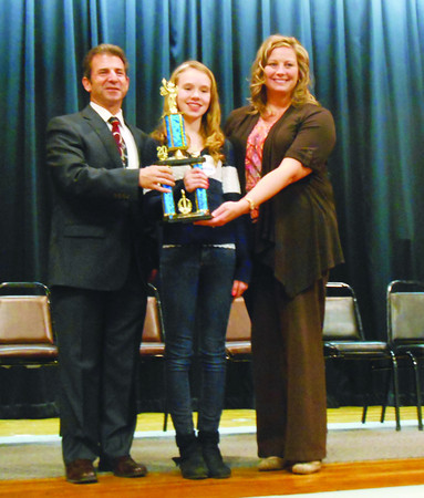 DEVASTASHA BEAVER / Star Beacon<br /> FIFTH-GRADER Julianna Sloan is the winner of the 31st annual Ashtabula County Area V Spelling Bee. Sloan attends Kingsville Elementary. Buckeye Superintendent Joe Spiccia (right) and Kingsville Elementary Principal Traci Landis congratulate Sloan on her win.