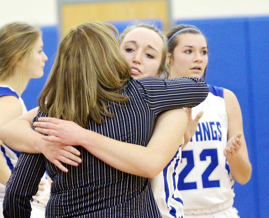 WARREN DILLAWAY / Star Beacon<br /> JESSICA VORMELKER of Grand Valley receives a hug from coach Kim Triskett after Vormelker scored her1,000 point during a home game with  Badger Thursday evening in Orwell.