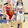 WARREN DILLAWAY / Star Beacon<br /> KELSEY MERRITT (10) of Grand Valley leads a fast break with  Liz Emery of Badger in hot pursuit on Thursday evening in Orwell.