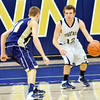 WARREN DILLAWAY / Star Beacon<br /> RICHIE BURR of Conneaut dribbles up court on Friday night with Derrick Dickson of Brookfield defending on Friday evening at Conneaut.