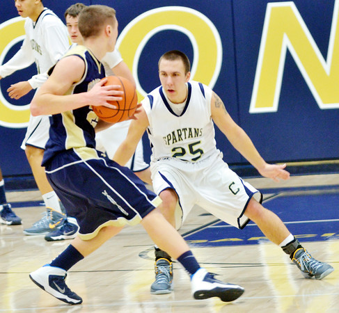 WARREN DILLAWAY / Star Beacon<br /> KYLE SPRINKLE (25) of Conneaut defends Brian Hiner of Brookfield on Friday night at Conneaut's Garcia Gymnasium.