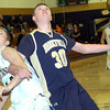 WARREN DILLAWAY / Star Beacon<br /> MARCUS BARRICKMAN (left) of Conneaut gets tangled up with Seth Wallace (30) of Brookfield on Friday night at Garcia Gymnasium in Conneaut.