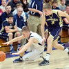 WARREN DILLAWAY / Star Beacon<br /> NICK ROOT of Conneaut dives for the ball in front of Caleb Hunkus of Brookfield on Friday night at Garcia Gymnasium in Conneaut.