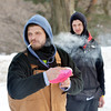 WARREN DILLAWAY / Star Beacon<br /> TREVOR DONAHUE of Columbus prepares to shoot as Aaro Collins watches ft during the Ashtabula Ice Bowl disc golf tournament at Lake Shore Park in Ashtabula Township on Saturday.