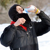 WARREN DILLAWAY / Star Beacon<br /> AARON COLLINS of Columbus takes a water break during the Ashtabula Ice Bowl disc golf tournament at Lake Shore Park in Ashtabula Township on Saturday.