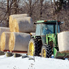 WARREN DILLAWAY / Star Beacon<br /> JUSTIN RING drives hay to the family dairy farm in Pierpont Township on Friday.