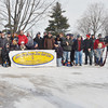 WARREN DILLAWAY / Star Beacon<br /> LARRY JENNINGS, president of the Shoot The Breeze Disc Golf Club, organizes a group picture before the start of the Ashtabula Ice Bowl on Saturday at Lake Shore Park in Ashtabula Township.