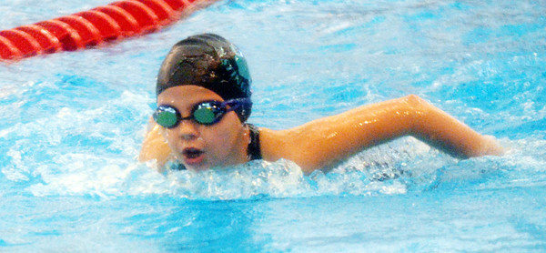 LEAH VENDETTI swims the butterfly leg of the 11-12 girls medley relay on Saturday at the YMCA Divisional Swim meet at Spire Institute.