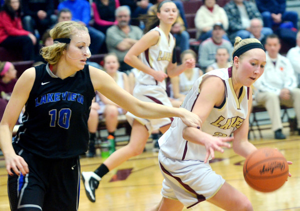 WARREN DILLAWAY / Star Beacon<br /> CALLI SCHMITT (left) of Lakeview battles for the ball with Megan Stech of Pymatuning Valley on Saturday in Andover Township.