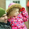 WARREN DILLAWAY / Star Beacon<br /> RICH PALMISANO and his daughter Gia, 2, both of Geneva, watch the Winterfest parade in downtown Geneva on Saturday.