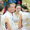 WARREN DILLAWAY / Star Beacon<br /> JEFF COMPAN, Pymatuning Valley girls basketball coach, talks to (from left) Kat Hall (35), Olivia Holden (5),Abby Hamilton (facing), Megan Stech (22) and Kelsea Brown (3) on Saturday during a home game with Lakeview.