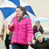 WARREN DILLAWAY / Star Beacon<br /> TAYLOR  BAUMGARDNER (left front) and Cole Baumgardner, 3, both of Geneva, try to stay dry at Winterfest on Saturday afternoon in downtown Geneva.