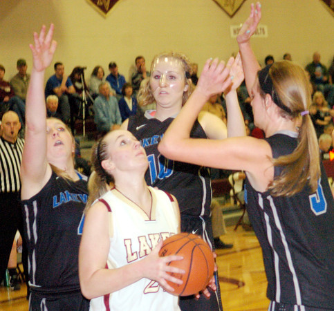 WARREN DILLAWAY / Star Beacon<br /> GEENA GABRIEL (with ball) of Pymatuning Valley is surrounded by Lakeview players (from left)  Rachelle Calvin, Calli Schmitt and Abby Pavlic on Saturday in Andover Township.
