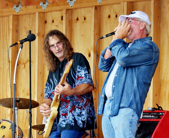 WARREN DILLAWAY / Star Beacon<br /> GENE BAKER (right), with harmonica in hand, joins Ed Dana on stage on Saturday during the Conneaut Dockfest.