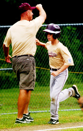 WARREN DILLAWAY / Star Beacon<br /> SAM SMITH and Major League All Star coach George Arenshield of New Albany celebrate after Smith hit a home run on Saturday during state tournament action at Cederquist Park in Ashtabula.