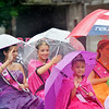 WARREN DILLAWAY / Star Beacon<br /> GENEVA WINTEREFEST royalty try to stay dry during the Multi-Cultural Festival parade on Saturday in downtown Ashtabula.