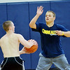 WARREN DILLAWAY / Star Beacon<br /> TROY COLUCCI (facing) defends Michael Mirando during a Conneaut open gym marathon fund raiser on Saturday at the Conneaut Middle School.