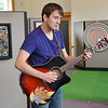 WARREN DILLAWAY / Star Beacon<br /> MARK KASCHAK performs at an art show during The Arts on Bridge Street Saturday in Ashtabula Harbor on Saturday afternoon.