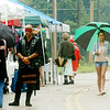 WARREN DILLAWAY / Star Beacon<br /> UMBRELLAS WERE a helpful tool on Saturday at the Multi-Cultural Festival in downtown Ashtabula. The event continues today at noon.