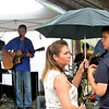 WARREN DILLAWAY / Star Beacon<br /> KARI MANCUSO holds an umbrella for Mario Mancuso while listening to the Loose Tooth Band on Saturday at The Arts on Bridge Street.