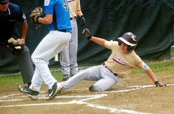 WARREN DILLAWAY / Star Beacon<br /> NICK SHORYER of the New Albany Major League All Stars slides safely home as Cameron Tenhundfeld (4) races to the plate during Little League state tournament action at Cederquist Park in Ashtabula on Saturday.