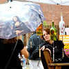 WARREN DILLAWAY / Star Beacon<br /> DEANNA PRICE of Canfield (facing) talks with April Stroberg of Mentor during The Arts on Bridge Street on Saturday in Ashtabula Harbor. Price was selling wind chimes and candle holders made out of bottles.