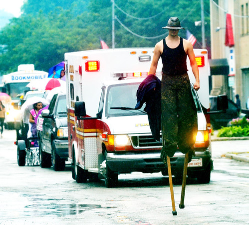 WARREN DILLAWAY / Star Beacon<br /> CONNOR BACON walks on stilts during the Multi-Cultural Festival parade on Main Avenue in Ashtaubla on Saturday.
