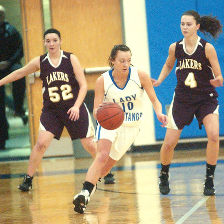 WARREN DILLAWAY / Star Beacon<br /> KELLY PRESKE of Grand Valley handles the ball with Pymatuning Valley defenders Heather Brant (52) and Abby Hamilton close by on Thursday evening in Orwell.