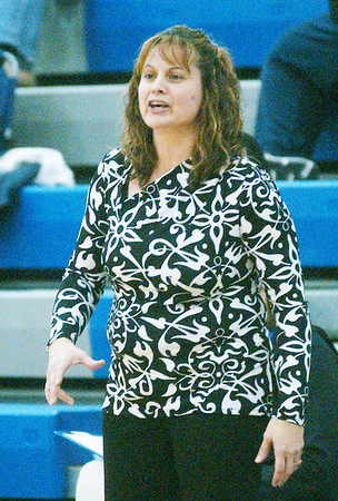 WARREN DILLAWAY / Star Beacon<br /> KIM TRISKETT, Grand Valley girls basketball coach, instructs her team on Thursday evening during a home game with Pymatuning Valley.