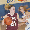 WARREN DILLAWAY / Star Beacon<br /> GEENA GABRIEL (21) of Pymatuning Valley dribbles while Grand Valley's Holly Nye defends on Thursday in Orwell.