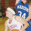 WARREN DILLAWAY / Star Beacon<br /> BECKY DEPP of Geneva drives to the basket in front of Madison's Julie Bruening on Saturday at Geneva.