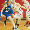 WARREN DILLAWAY / Star Beacon<br /> JULIE BRUENING (34) of Madison tries to find open space while defended by Geneva's Becky Depp on Saturday at Geneva.