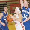 WARREN DILLAWAY / Star Beacon<br /> BECKY DEPP of Geneva drives to the basket in front of Madison's Julie Bruening (34) with Blue Streak Abigail Trivisonno watching on Saturday at Geneva.