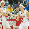 WARREN DILLAWAY / Star Beacon<br /> THE DEPP sisters Sarah (left) and Becky celebrate after defeating Madison with a shot in the last several seconds of the game in Geneva.
