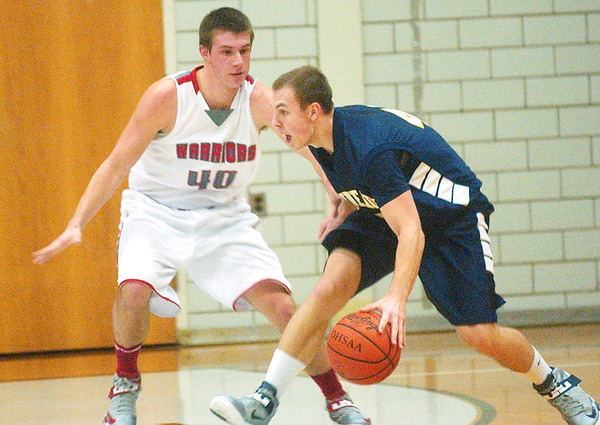 WARREN DILLAWAY / Star Beacon<br /> CHRISTIAN WILLIAMS (with ball) of Conneaut looks for an open teammate as Edgewood's Andrew Konczal defends on Friday night at Edgewood.