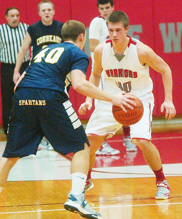 WARREN DILLAWAY / Star Beacon<br /> ANDREW KONCZAL (facing) of Edgewood defends Conneaut's Christian Williams on Friday night at Edgewood.