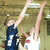 WARREN DILLAWAY / Star Beacon<br /> DYLAN CAMPBELL of Conneaut releases a shot as Edgewood's Matt Fitchet goes for the block on Friday night at Edgewood.
